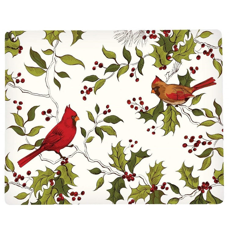 Hardboard placemat showing red cardinals and green holly branches with red berries on a white background.