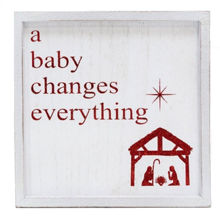 White wood shadow box with red glitter lettering. A baby changes everything. Also shows nativity and star.