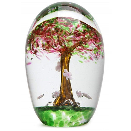 Clear glass paperweight figurine with cherry tree encased under clear.