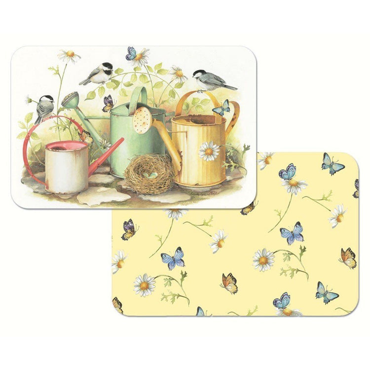 2 placemats, 1 is yellow with butterflies & daisies. 1 shows 3 watering cans, a bird nest, birds and butterflies.