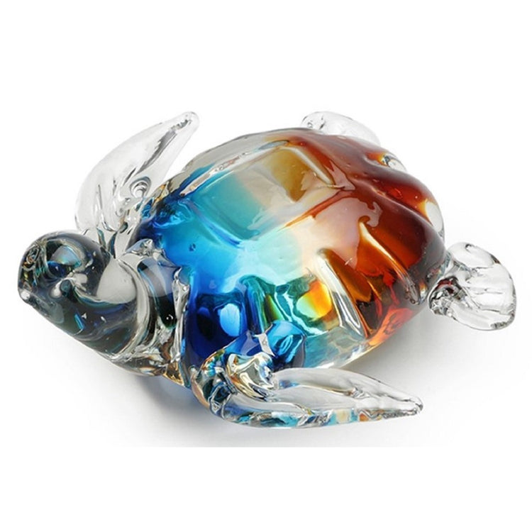Clear glass turtle figurine with rainbow colors under clear on shell.
