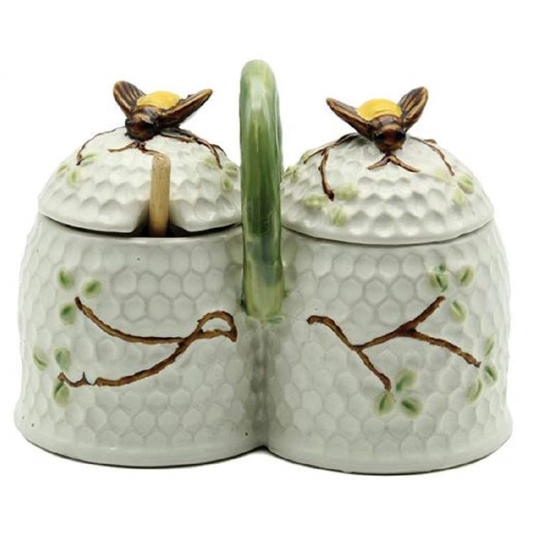 double condiment jar attached with bumble bee tops and green handle.