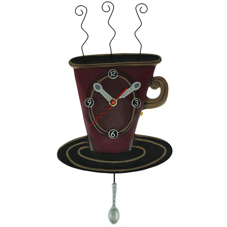 Dark red coffee cup design clock. Clock has spoon shaped hands and a spoon shaped pendulum.