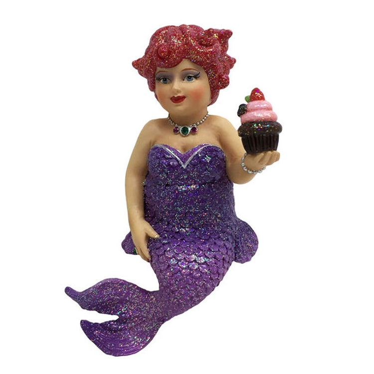 Mermaid figurine ornament.  Dressed in purple holding a cupcake.