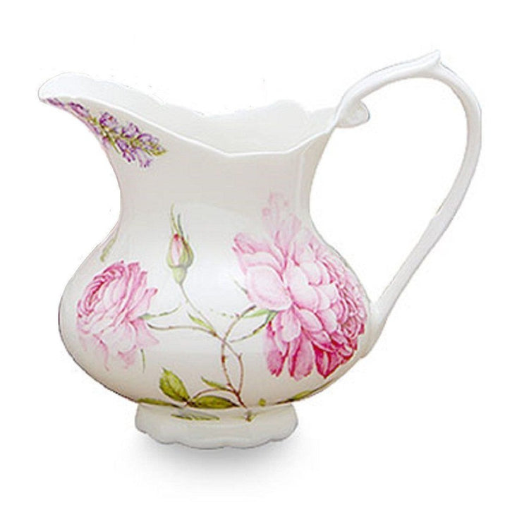 White creamer with pink floral print.