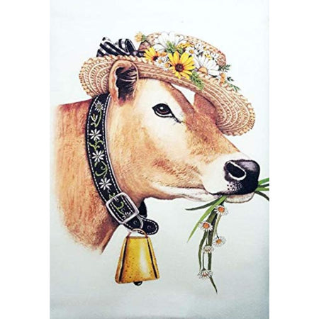 White flour sack kitchen towel with cow imprint wearing a flower covered hat and wearing a bell.