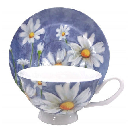 White cup with matching saucer standing up behind it.  Blue with white daisies.