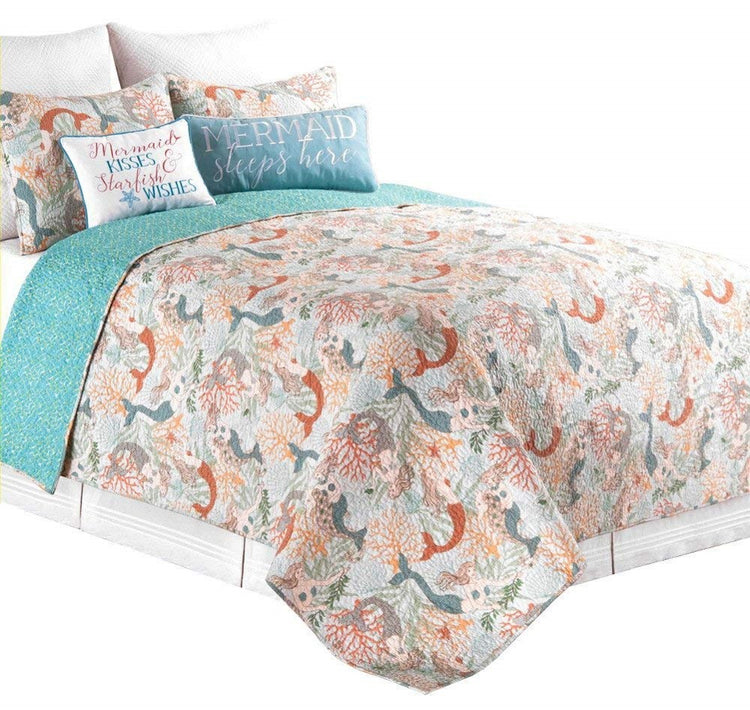 Bed with reversible comforter.  Patterned teal on one side, mermaids with coral on other side. Shades of orange to teal.   Matching 2 shams and 2 other pillows not on sale.