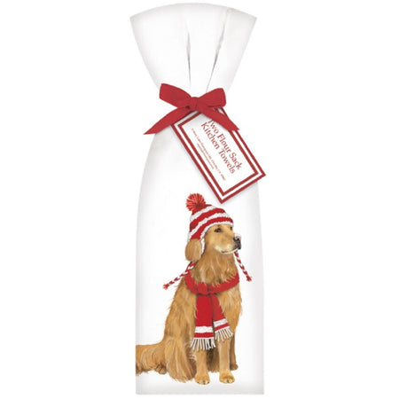 2 white towels tied with a red ribbon. Towel shows a golden retriever  in a red and white winter hat and a red scarf.