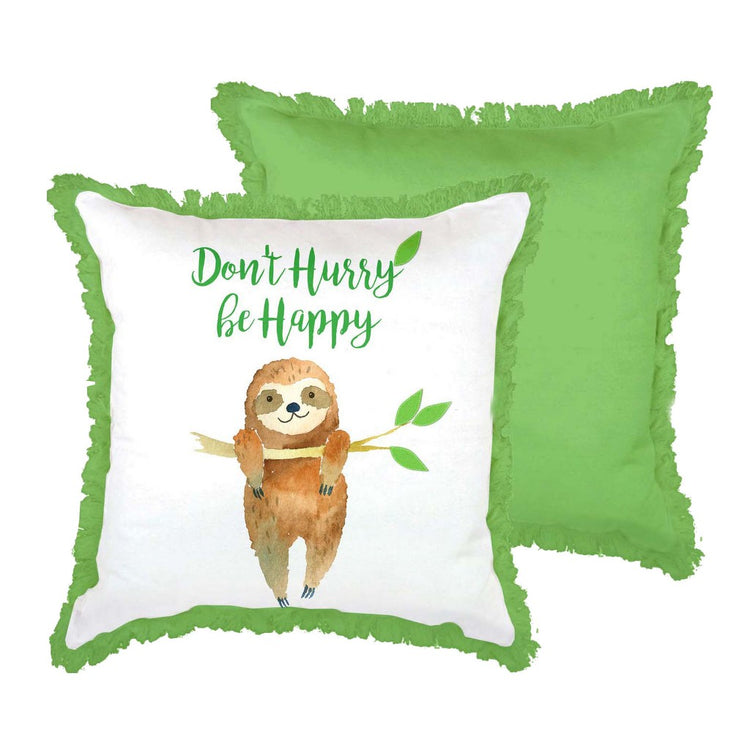 "White pillow with green fringe. Text ""Don't Hurry be Happy. below text a smiling sloth is hanging from a tree branch"