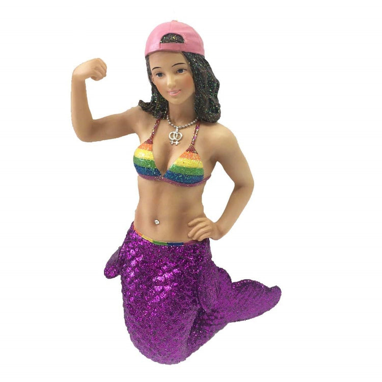 Mermaid figurine hanging ornament.  She has a purple tail and rainbow colored bathing suit top.  Pink baseball cap on backwards she is in a bicep muscle pose.