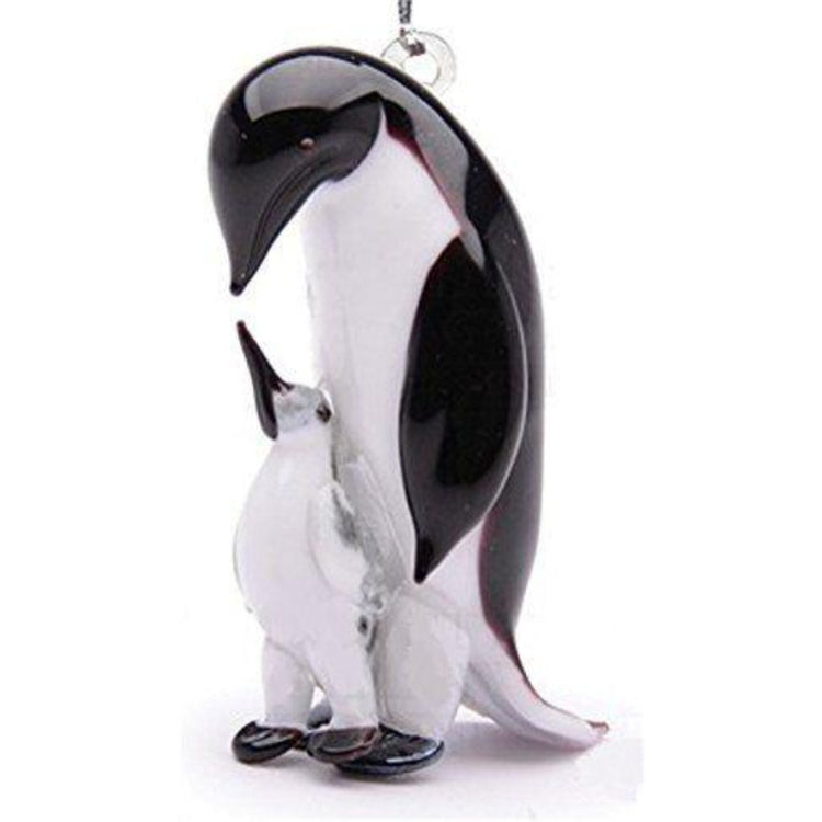Father penguin looking down at baby glass figurine ornament.