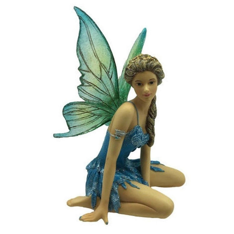 Fairy figurine shaped hanging ornament.  She is sitting on knees wearing an arm band and blue dress.