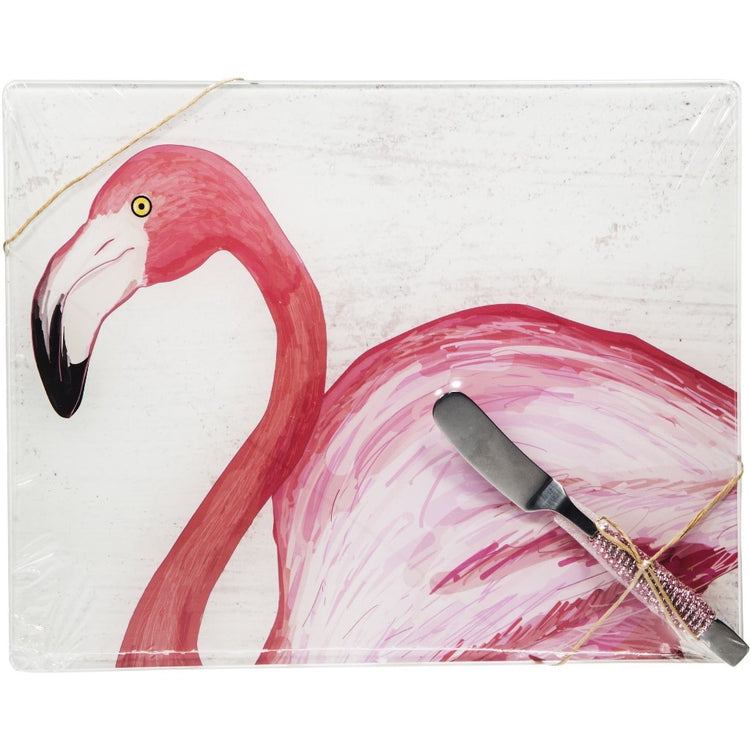 Marble looking background with a bright pink flamingo n the forefront.