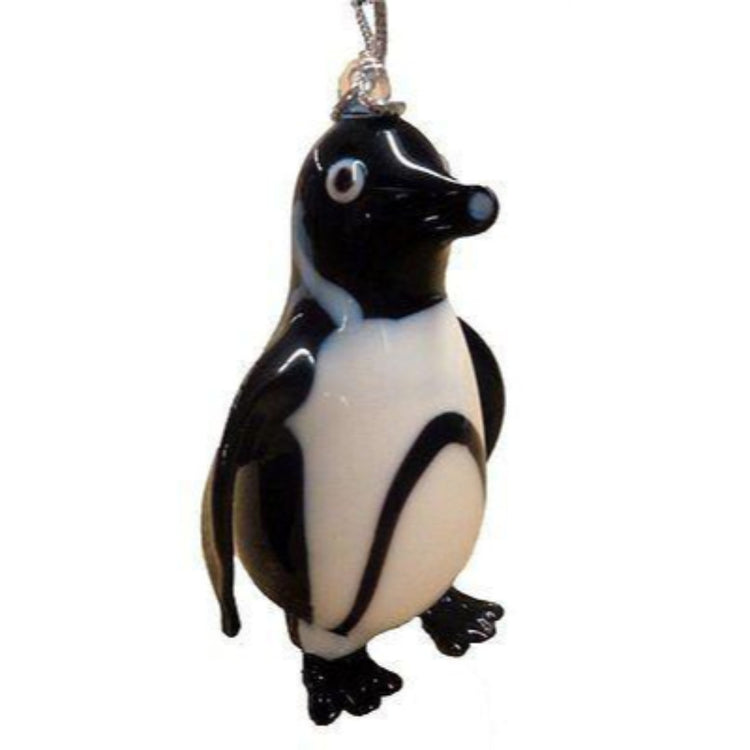 Black and white penguin shaped Christmas ornament with silver cord.