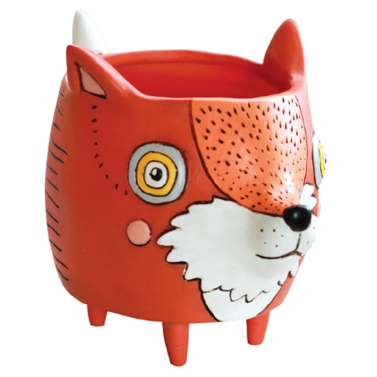 Red and orange round fox face planter pot. Fox has white stripe down its forehead.