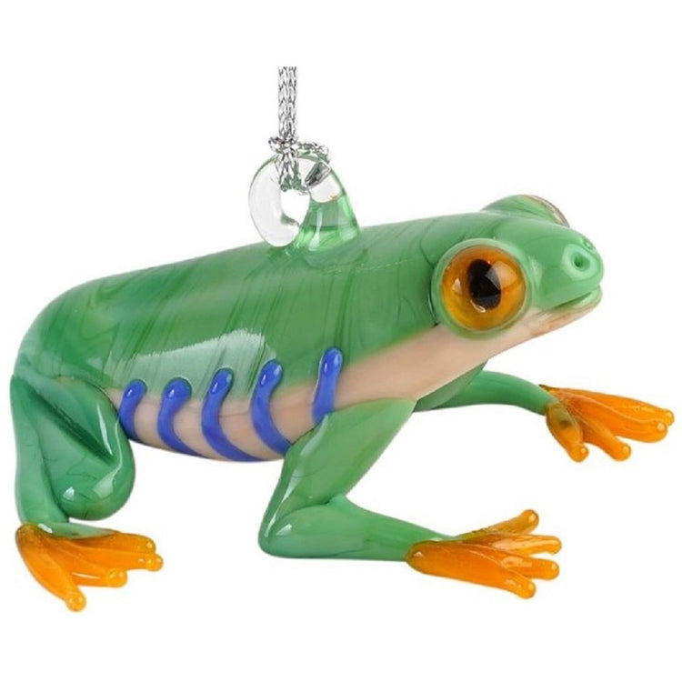 Glass frog ornament. Sitting on hind legs looking up. Light green skin with yellow feet, white belly with blue stripes