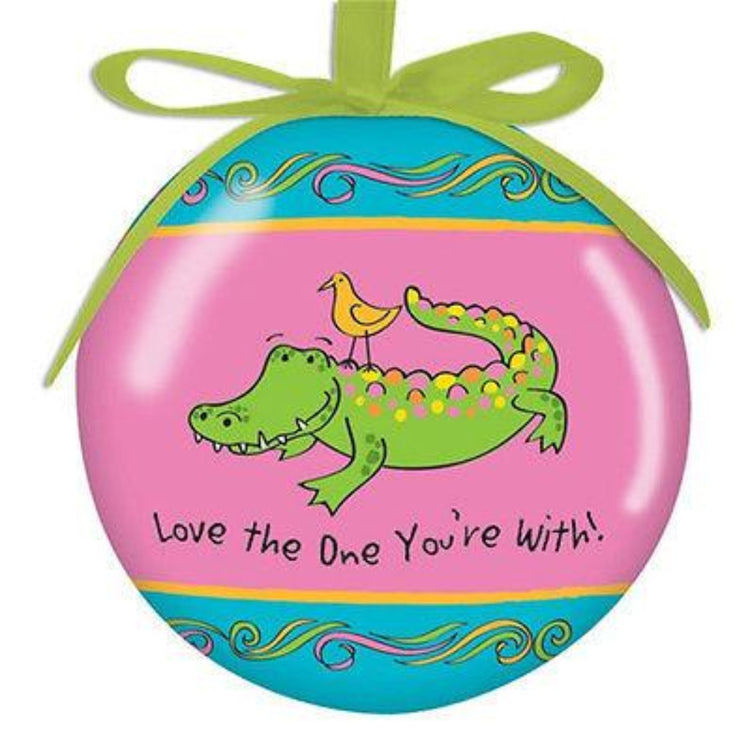 Round Hanging Christmas Ornament with green ribbon cord.  Teal and Pink with alligator and yellow bird.