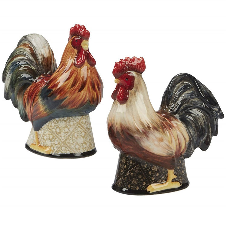 2 rooster shaped shakers one brown with darker tail feathers, 2nd white with dark tail feathers. Both have a bright red crest