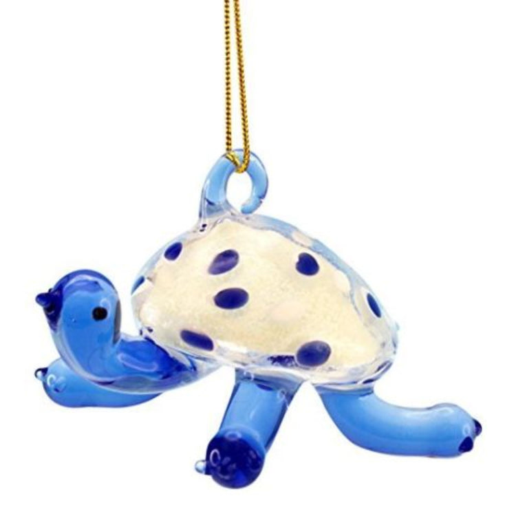 Blue clear glass turtle with white shell with blue dots. Hanger is on back of shell.