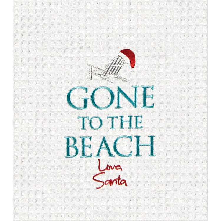 "White towel, adirondack chair with santa hat on top. Text ""Gone to the Beach"" under that signature looking text ""Love Santa"""