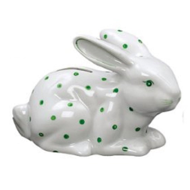 Laying white rabbit bank with green spots, eye and whiskers. Coin slot on back.