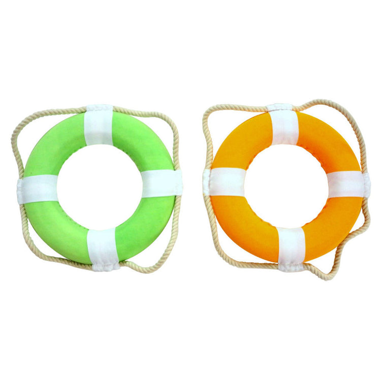 2 life preserver rings, 1 is orange & white, the other is green & white. The rope is a cream color.