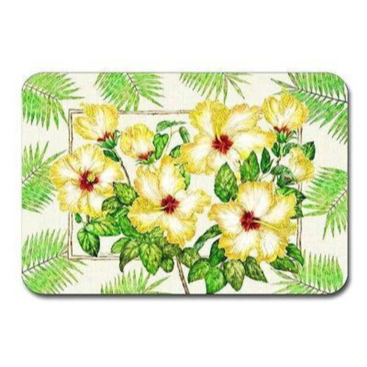 White placemat with yellow hibiscus and green palm frond pattern.
