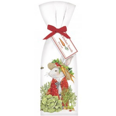 2 white towels tied with red ribbon. Towel shows a white bunny in a red jacket & hat. Around him are garden vegetables.