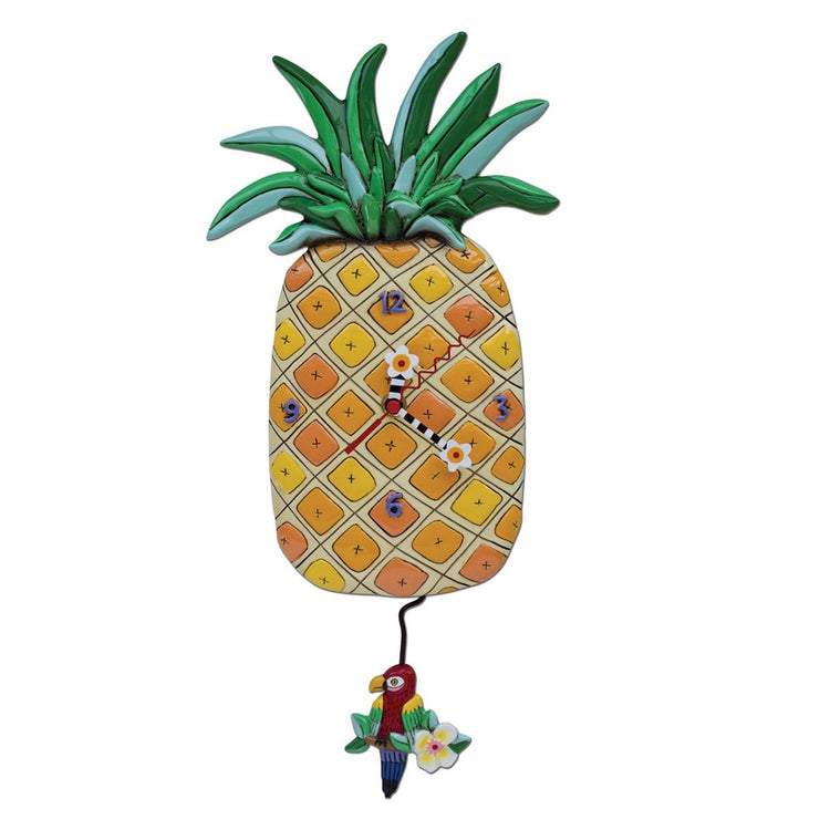 pineapple shaped clock with parrot pendulum hanging underneath. Hands are red, black, white & yellow.