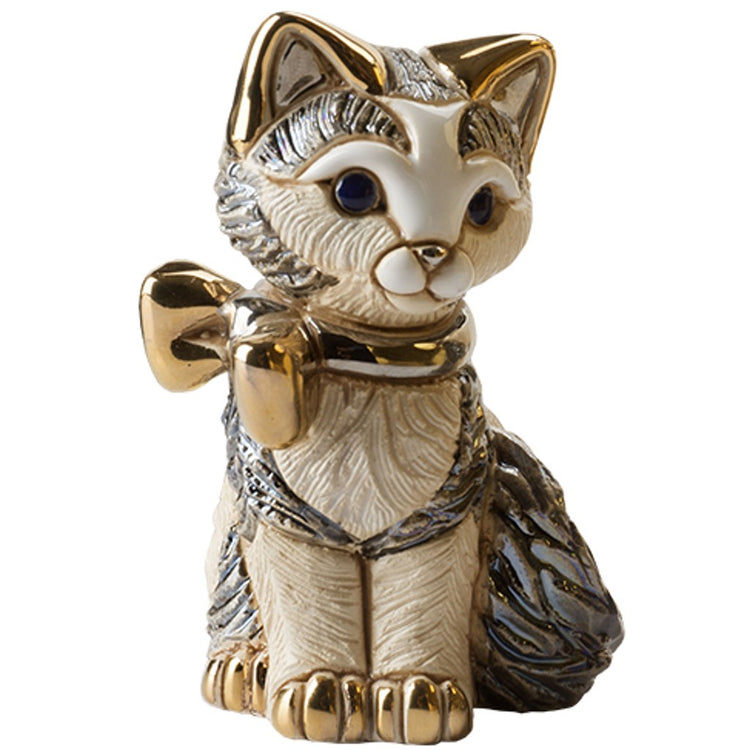 Kitten shaped figurine gazing forward.  Bold with black accent wearing a gold bow.  Lots of texture.