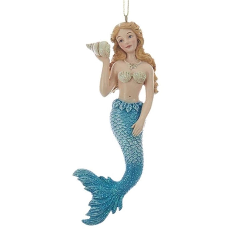 Mermaid figurine holding a shell ornament in blue.