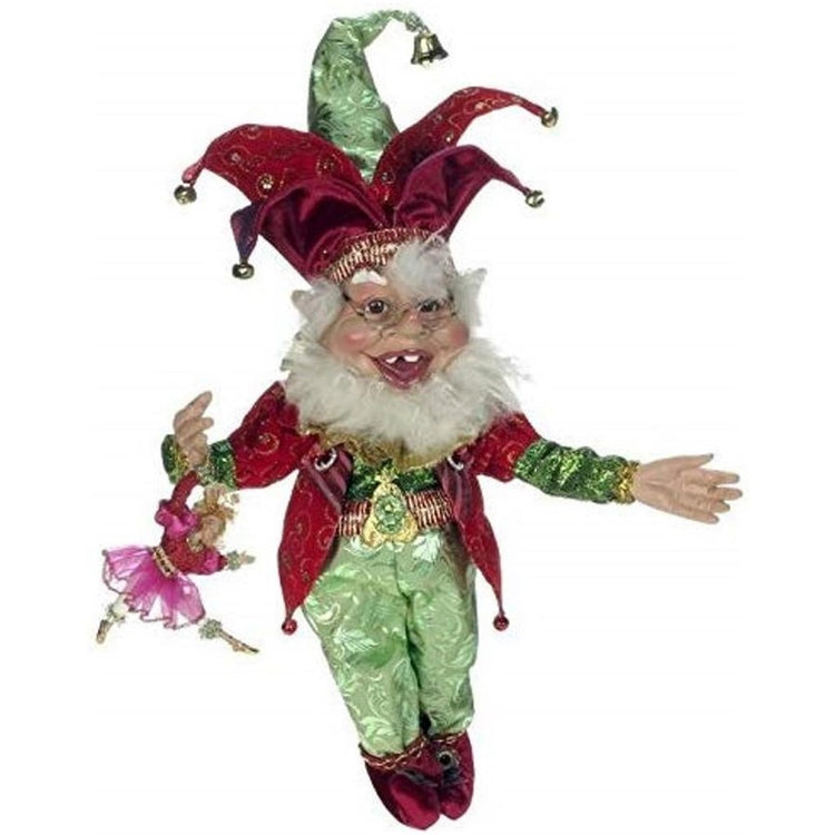 Elf figurine, white beard wearing shades red and green outfit, red boots jester hat carrying a doll.