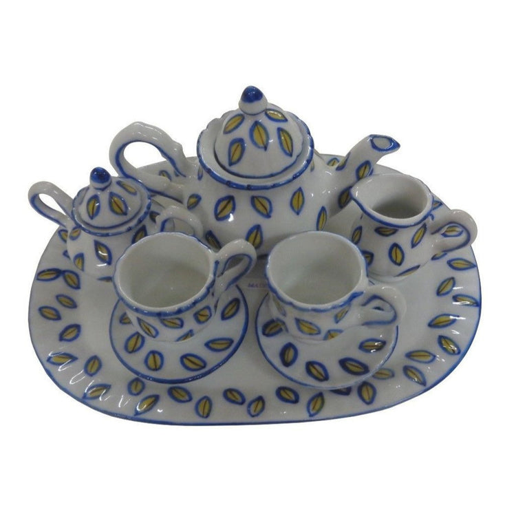 Tea set for 2.  Yellow flowers on white on teapot, sugar, creamer, 2 cups and saucers and tray.