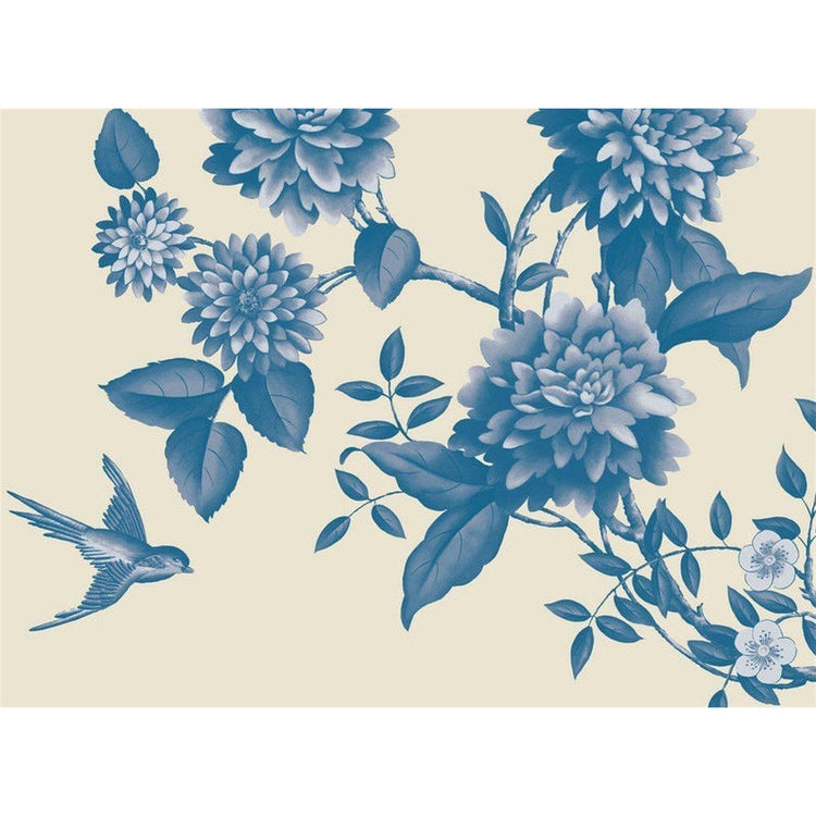 Cream colored placemat with blue flower and bird design.