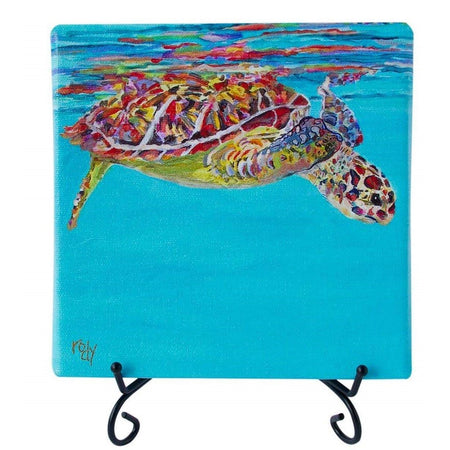 Stretched canvas print on black wire stand. Turtle swimming just below the surface of water looking down.
