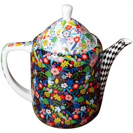 Modern very busy teapot with bright colored flowers on black on pot.  Flowers on white on lid and handle, black and white diamond pattern on spout.