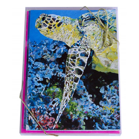 Blue notecard showing a painted sea turtle and pink envelopes.
