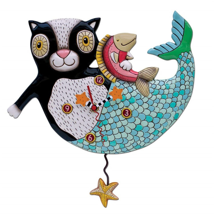 Clock designed to be a black cat with a blue mermaid tail holding a fish. Clock hands and pendulum are starfish.