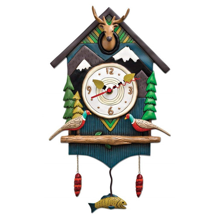 cuckoo style clock. The clock is blue with a mountain scene, two birds, cuckoo is a deer head. Pendulum is a yellow fish.