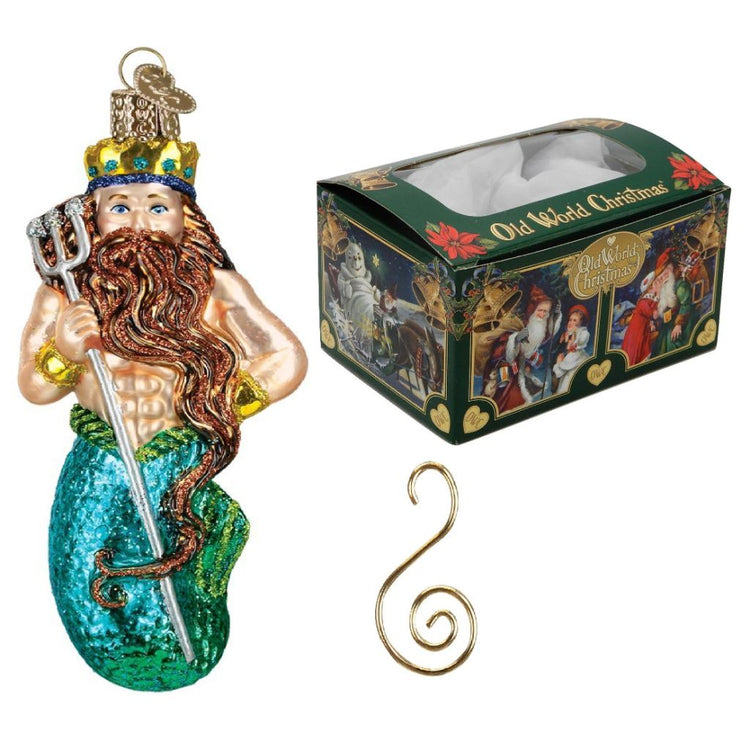 "King Neptune ornament on left. Top right green gift box, text ""Old World Christmas"". Bottom right is gold  S style hook"