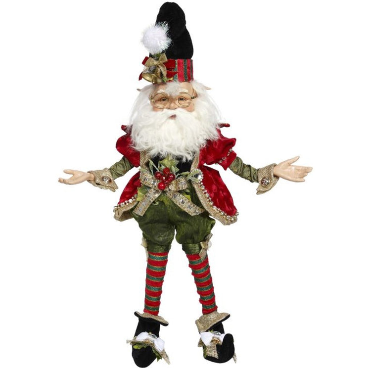 Elf figure wearing traditional red and green with berries and bow on belt.