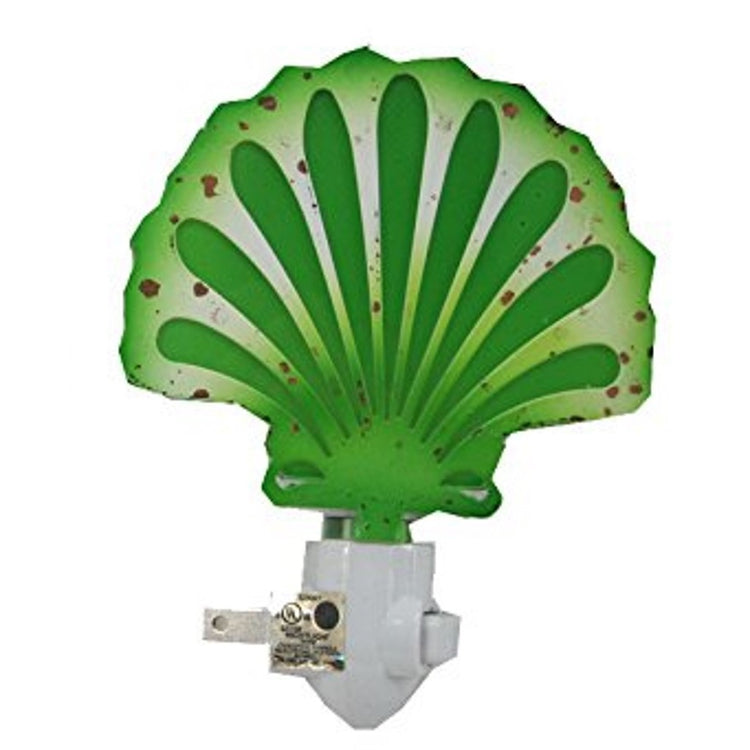 Green with brown spots shell shaped night light.