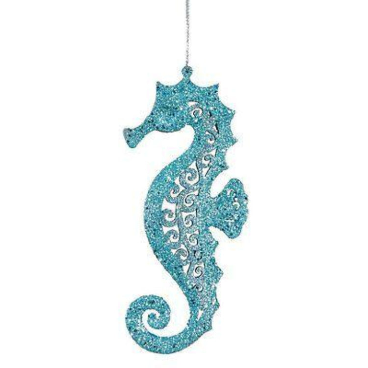 Teal glitter seahorse ornament hanging from silver string.