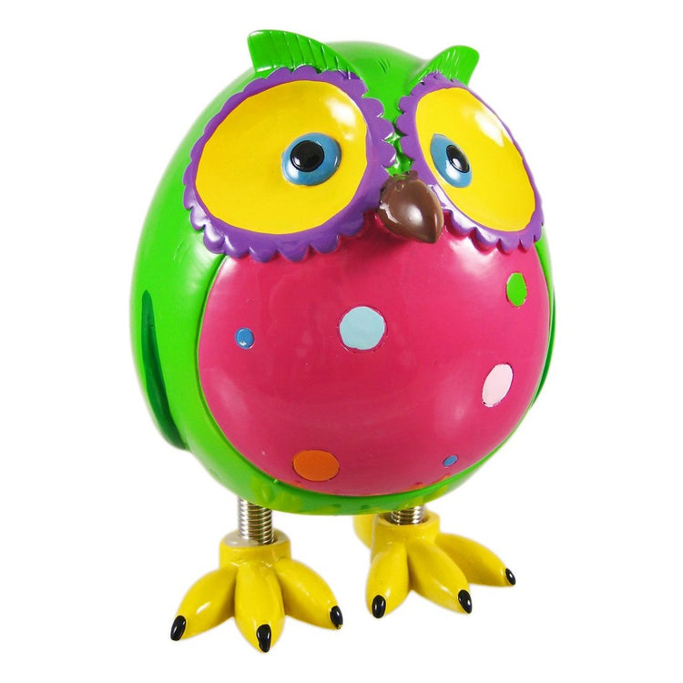 Owl standing on spring legs. Body green, pink belly with spots, yellow feet and ring around eyes. Beak is brown