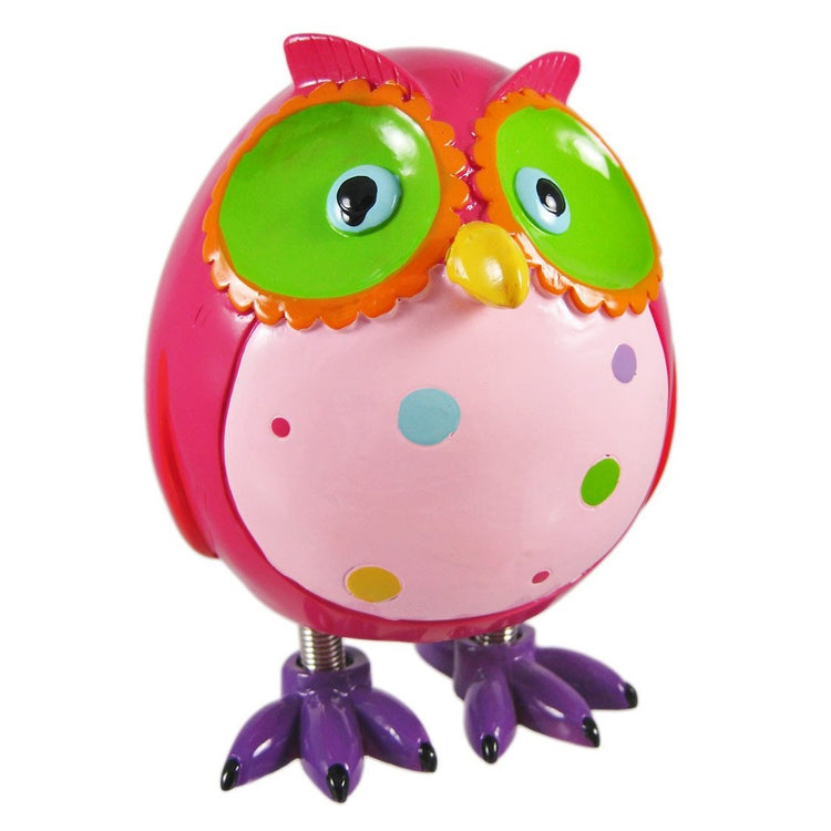 Owl shaped figurine coin bank with spring legs and bright colors of pink, green and orange.