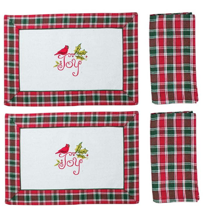 "2 white placemats with red and green plaid boarder.  Red cardinal in center ""Joy"" with 2 matching plaid napkins."