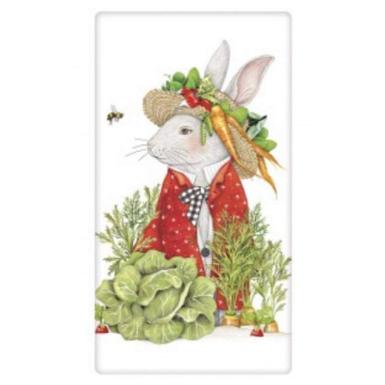 White rabbit in a hat with carrots, lettuce, and radishes.