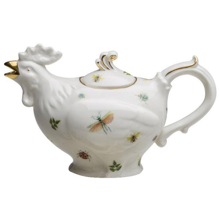 Rooster shaped white teapot with dragonfly prints and gold accents.