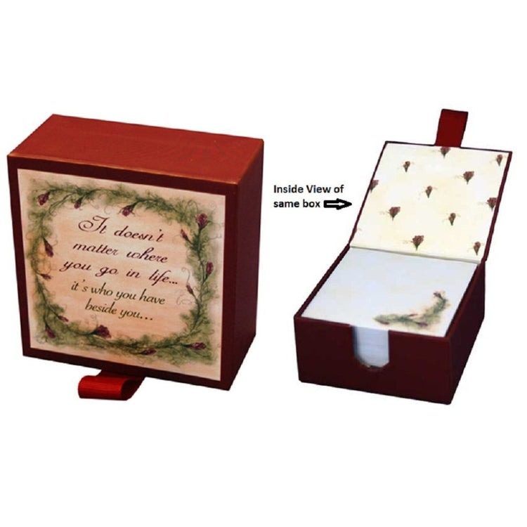 Maroon square box that opens displaying white notecards with pine floral print.